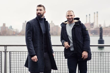 On Leddy: (Here) Houndstooth overcoat by Ovadia & Sons ($1,595); turtleneck by Ovadia & Sons ($395); cargo pants by Duluth Trading Company (Leddy's own, throughout). (Above) Ten-C fishtail parka by C.P. Company ($2,200; sweater by Todd Snyder ($295); chambray shirt by Orslow ($250). On Boychuk: (Here) Down parka by Stone Island ($1,785); sweatshirt by Stone Island ($225); jeans by DL 1961 (Boychuk's own, throughout); North Flag watch by Tudor ($3,550). (Above) Suede belted carcoat by Eidos Napoli ($2,995); turtleneck by Alex Mill ($195).