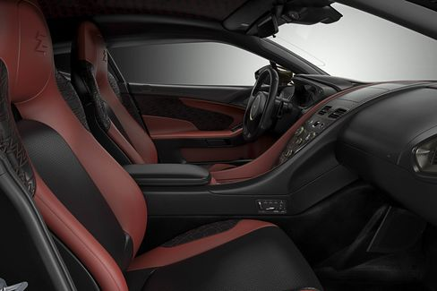 """Aston has added herringbone-patterned carbon fiber with leather and """"Z"""" quilt stitching on the headrest, seats, center console, and door sections."""