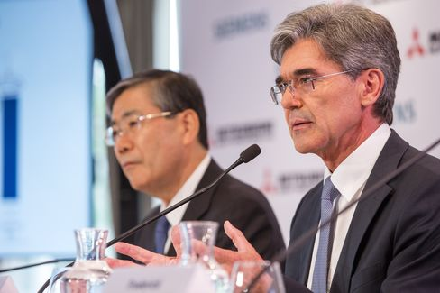 Siemens CEO Kaeser and Mitsubishi Heavy CEO Miyanaga