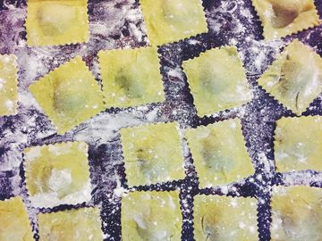 Fresh ravioli filled with wilted ramps and breadcrumbs.