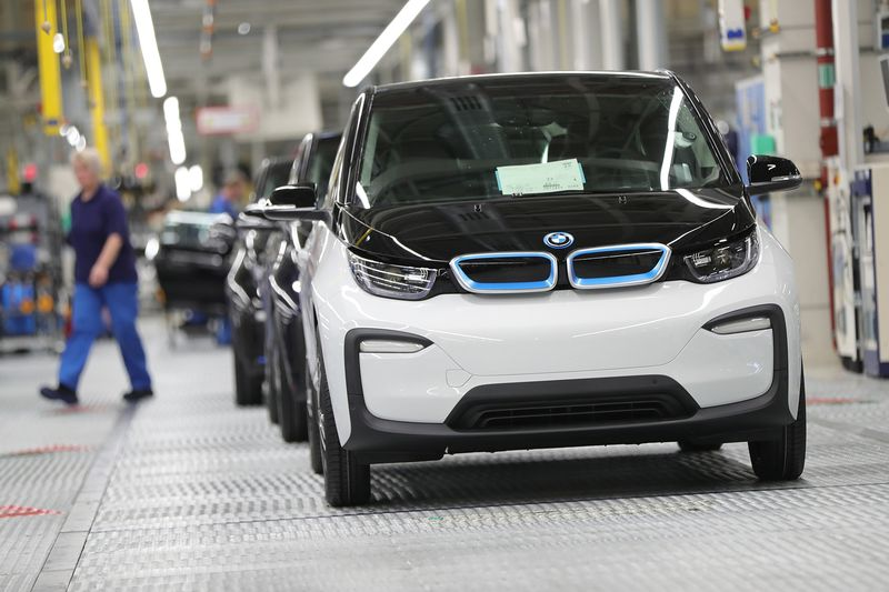 Newly assembled BMW i3 electric automobiles sit on the final quality control line at the BMW factory in Leipzig.