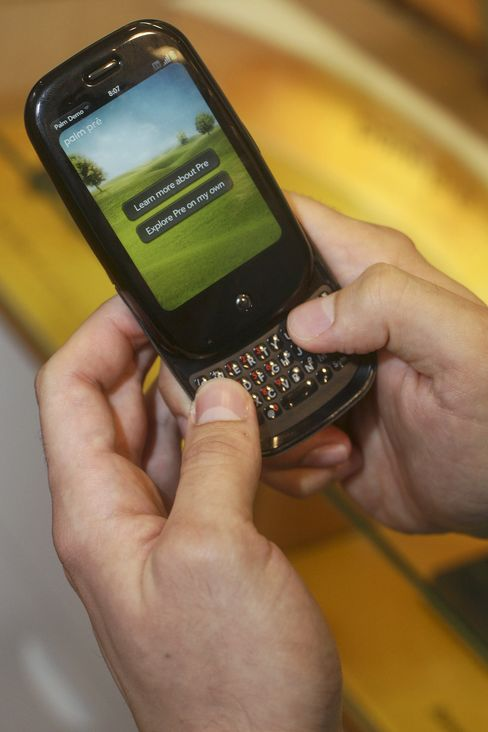 A customer tries out the Palm Pre mobile phone