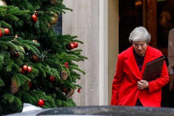 May Gets Cudgel Against Rebels in Brexit Twist