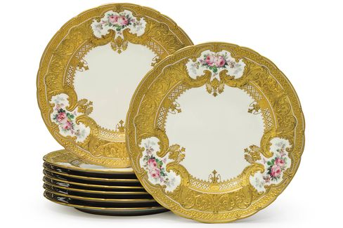 A set of eight royal crown derby porcelain parcel-gilt plates from 1902-1903, estimated to sell for $5,000 to $7,000 at Christie's.