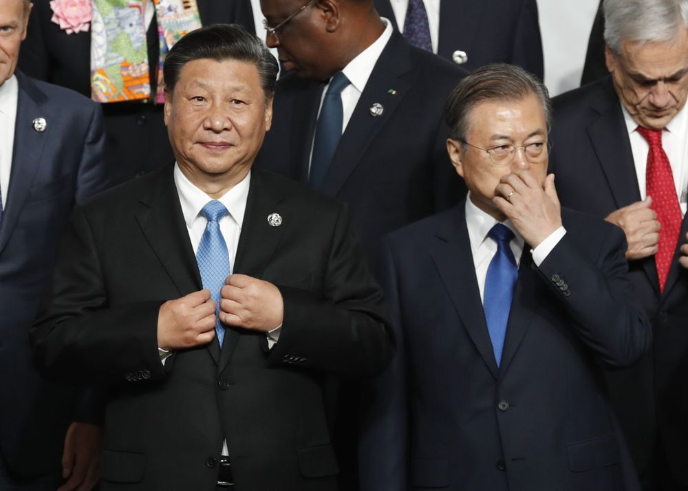 Xi Jinping, left, and Moon Jae-in, at the G-20 summit in Osaka, Japan, in 2019.