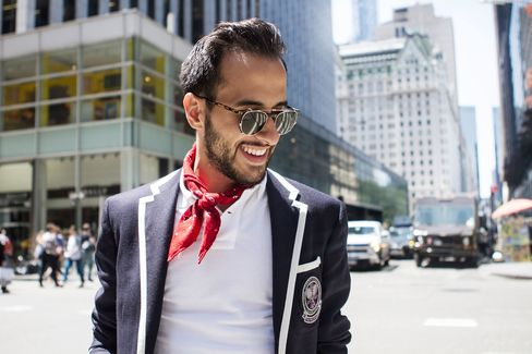 For his last look of the week, Moti pairs a cotton blazer with a polo and jeans, all by Polo Ralph Lauren.