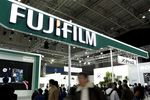 Attendees walk past the Fujifilm Holdings Corp. booth at the CP+ Camera and Photo Imaging Show in Yokohama, Kanagawa Prefecture, Japan.
