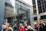Pedestrians pass in front of a Charles Schwab Corp. office building in New York.