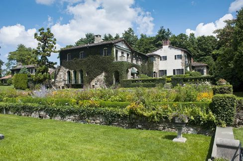 The house has acres of manicured gardens.
