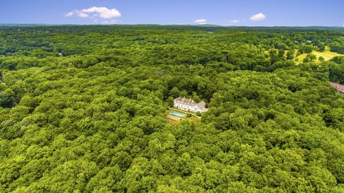The house is surrounded by a 300-acre nature preserve.
