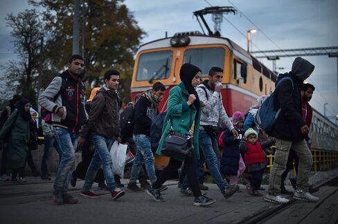 Migrants arrive by train at Kljuc Brdovecki before crossing over the Slovenian border to Rigonce in Zagreb, Croatia.