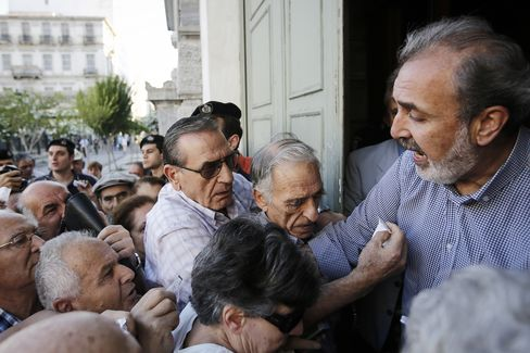 Pensioners with tickets enter a National Bank of Greece SA bank to collect their pensions in Greece, on July 1, 2015. Photographer: Simon Dawson/Bloomberg