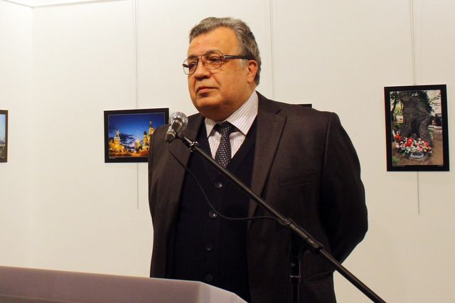 Andrey Karlov speaks at a in Ankara before being shot on Dec. 19 2016