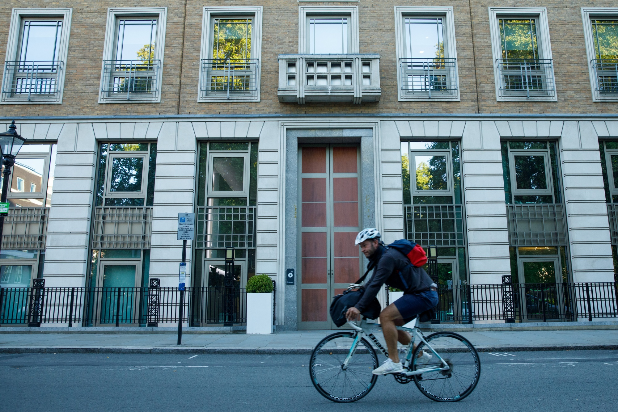 A cyclist passes the headquarters of BP Plc in London.