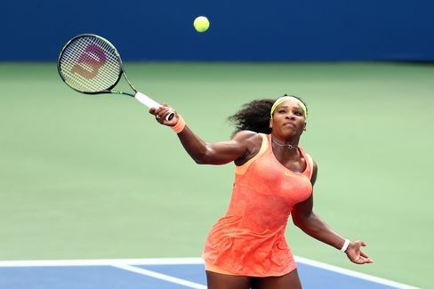 Serena Williams of the United States returns a shot to Roberta Vinci of Italy during their Women's Singles Semifinals match on Day Twelve of the 2015 US Open, on Sept. 11, in New York City.