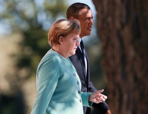 Merkel NSA Anger Won't Undercut Trade Ties With U.S., Joffe Says