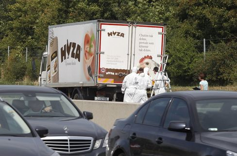 Forensic officers inspect a truck inside which were found a large number of dead migrants on a motorway near Neusiedl am See, Austria, on Aug. 27, 2015.
