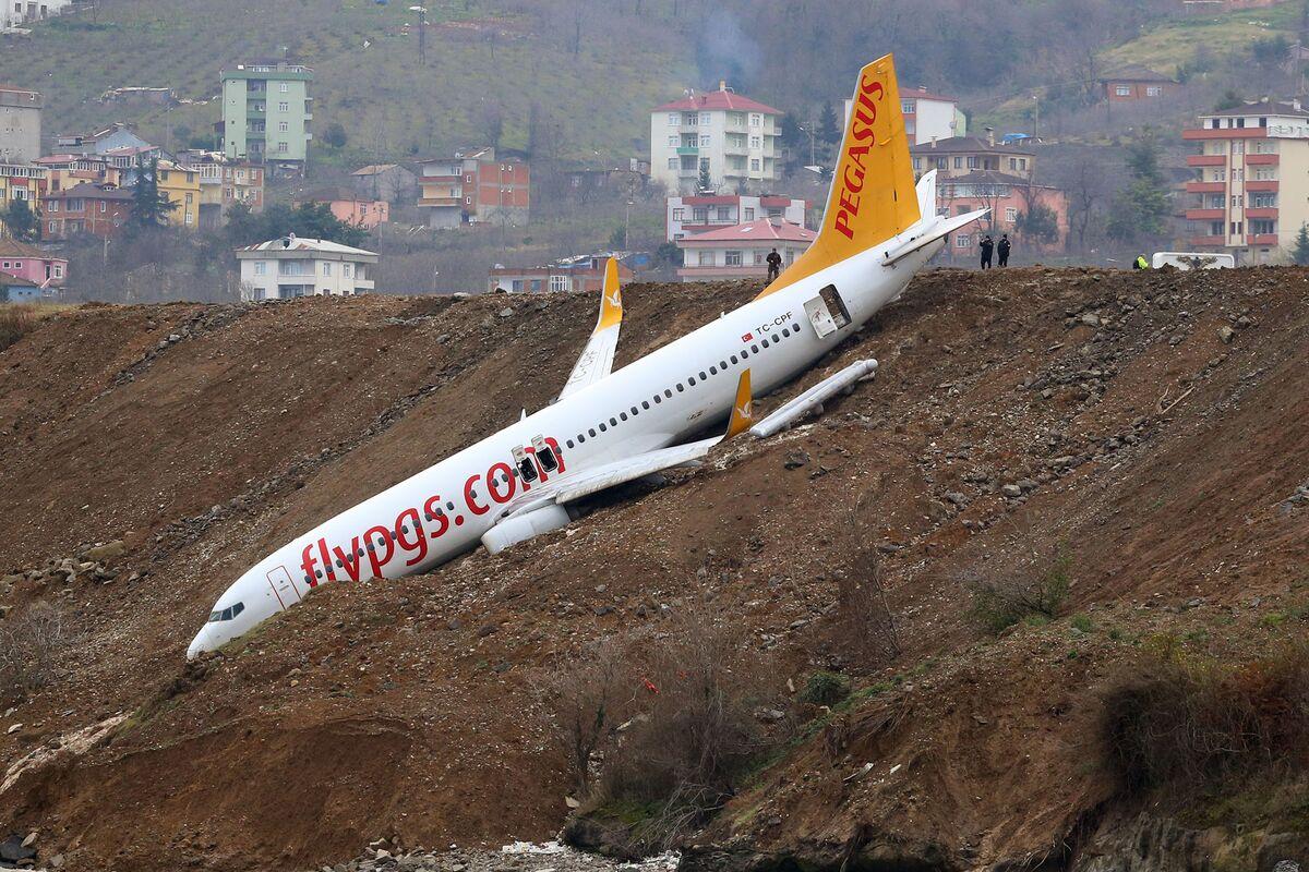 Passenger Jet Dangles Off Cliff After Skidding Off Runway