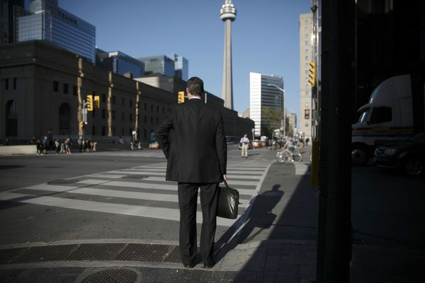 Commuters On Bay Street As Canadian Stocks Mixed