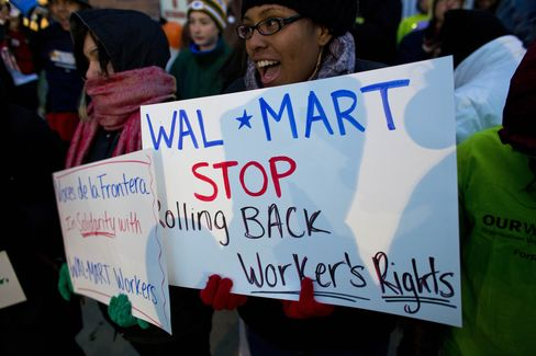 Wal-Mart Union Protests Fail to Deter Bargain-Seeking Crowds