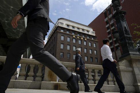 Nomura Leads Brokerages Higher After Profit Surges