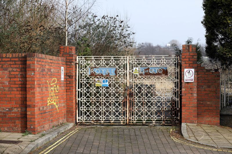 A rusting sign is displayed on the gates of the closed down Royal Doulton factory in the Burslem area in Stoke-on-Trent, U.K., on Tuesday, Feb. 14, 2017. Passions have been running high in Stoke Central, which fell vacant when Tristram Hunt quit as its lawmaker to take a job running London's Victoria and Albert Museum. Photographer: Chris Ratcliffe/Bloomberg