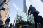Office workers walk near the Goldman Sachs Group Inc. headquarters in New York, U.S., on Thursday, July 22, 2021. After a year of Zoom meetings and awkward virtual happy hours, New York's youngest aspiring financiers have returned to the offices of the city's investment banks, where they're making the most of the in-person mentoring and networking they've lacked during the pandemic.