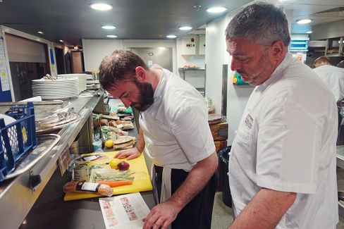 Richard Corrigan (right) studies the Marley Spoon recipe with his head chef, Alan Barrins.