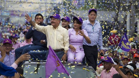 Danilo Medina waves to supporters.
