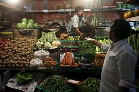 India Unexpectedly Holds Rate as Inflation Curbs Easing