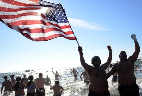 Members Of Coney Island's Polar Bear Club Take Icy Dip On New Years Day
