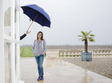 Winemaker Caroline Frey shelters under an umbrella at Chateau La Lagune in Margaux, France.