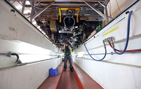 An employee works on the bogey of a London Underground train carriage at the Bombardier factory in Derby, U.K.