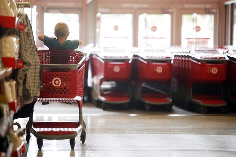 A Child Sits inside a Shopping Cart at a Target Corp. Store