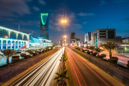 Kingdom Tower stands alongside the King Fahd highway illuminated by the light trails of passing traffic, in Riyadh, Saudi Arabia.