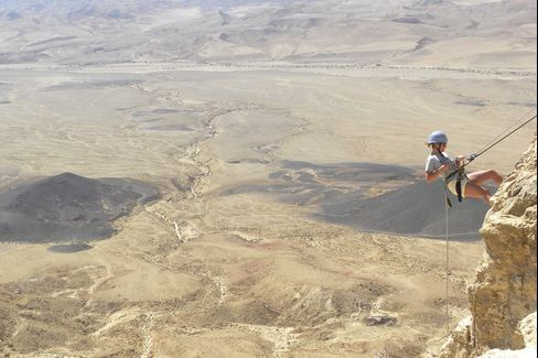 Rappelling into the Makhtesh Ramon, near the Beresheet Hotel.