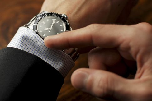 Well-dressed man checking the time on his wristwatch