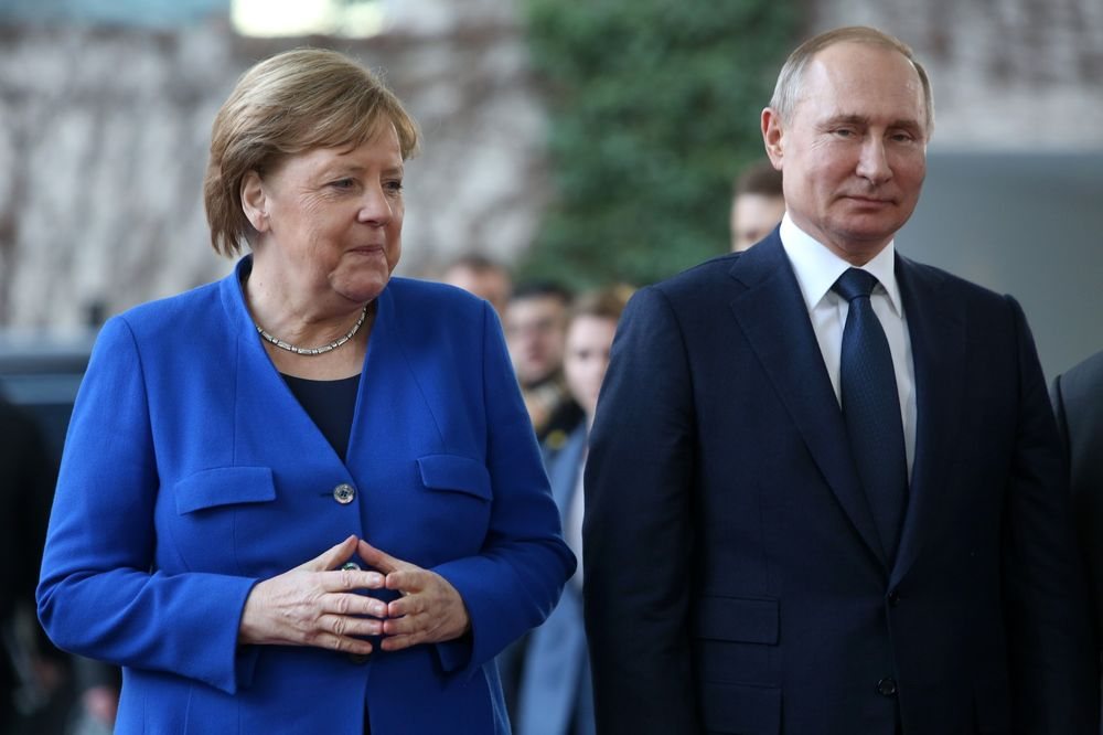 Trump Undermines Merkel As She Tries To Stand Up To Putin Bloomberg