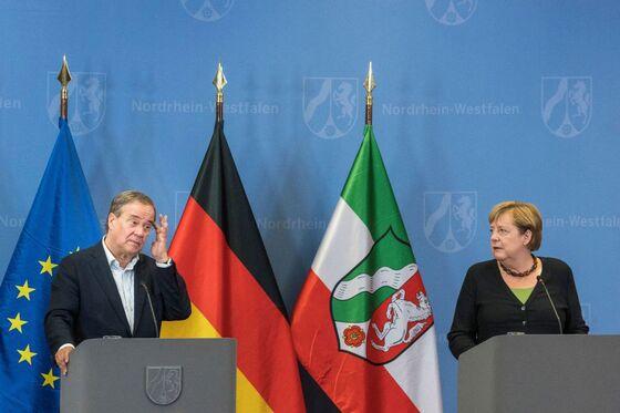 Merkel Goes to Bat for Laschet as Poll Slump Continues
