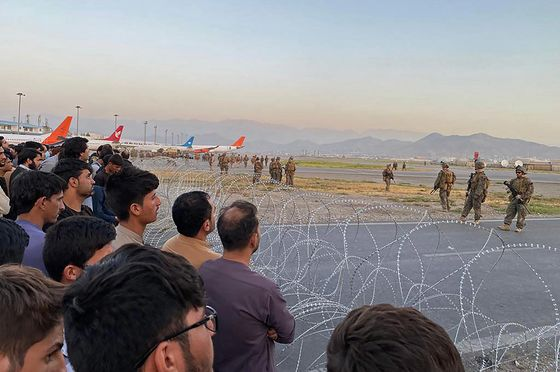 Chaotic Scenes Grip Kabul's Airport, With Reports of Deaths