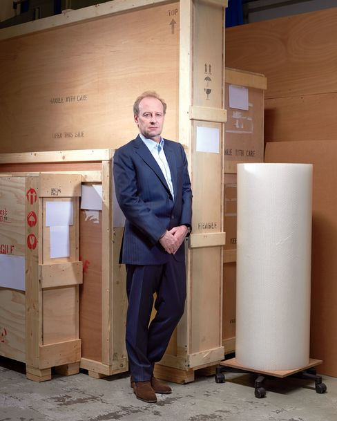 Yves Bouvier stands inside the freeport in Geneva where he started an art shipping business in the late 1980s.