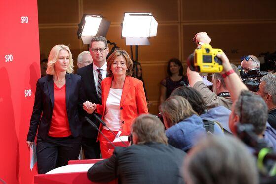 Merkel Gets a Break as Partner Stays in Coalition, For Now