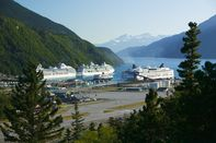USA, Alaska, Skagway, cruise ships and ferry in harbor