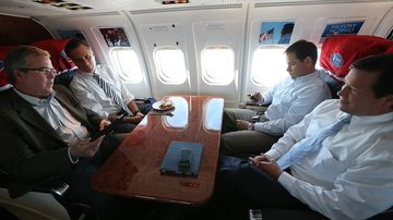 From left to right, former Florida Governor Jeb Bush, former Massachusetts Governor Mitt Romney, Senator Marco Rubio, and Representative Connie Mack sit aboard a campaign plane on Oct. 31, 2012, en route to Miami.