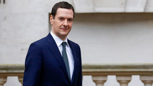 Britain's Chancellor George Osborne's leaves the Treasury in London