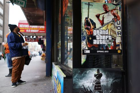 An advertisement for the new Grand Theft Auto is displayed outside of a gaming store on Jan. 11, 2013 in New York City.