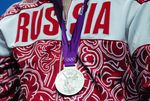 A Russian athlete receives a silver medal at the 2012 London Olympic Games.