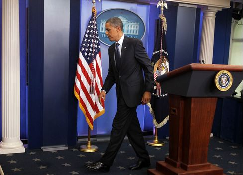 President Obama leaves a press conference on the budget deficit in 2011.