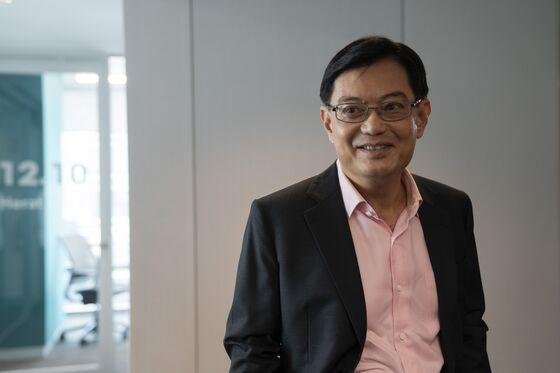 Singapore Minister Warns Full Pandemic Brunt Not Yet Felt