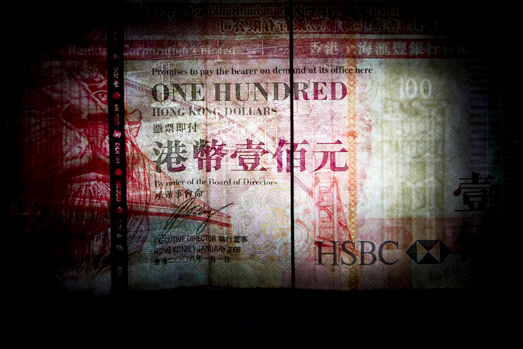 Image result for Photographer: Brent Lewin/Bloomberg Hong Kong's Crowded Currency Trade Enters Perilous Territory
